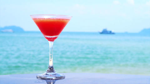 Video of red cocktail on the summer tropical beach Footage