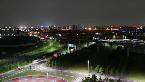 Elevated timelapse of Tokyo's rapid commuters traveling around the Haneda Footage