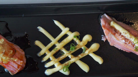 Seared salmon nigiri sushi with cheese and mayonnaise decoration in japanese cui Footage