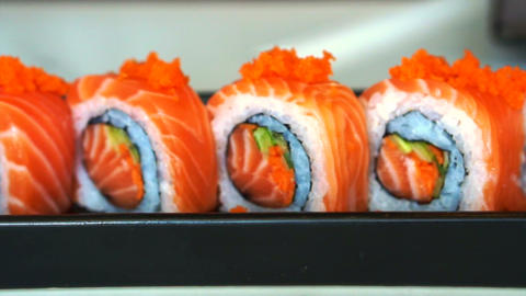 Video of salmon maki roll. Japanese sushi cuisine with fresh raw fish Footage