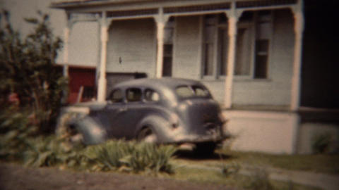 1962: Classic gray Dodge car parked suburban house driveway Footage