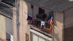 Clothes dry at sunlight, telephoto shot, recessed balcony at Barcelona Footage