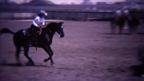 1967: Equestrian horse competition gallop jumping fence obstacle Footage
