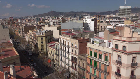 Barcelona houses and rooftops at Carrer de la Creu Coberta, pan aerial shot Footage