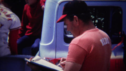 1972: Little league baseball dad coach clipboard tracking team Footage
