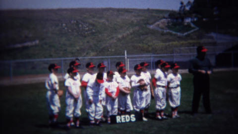 1972: Reds little league baseball team photo in outfield Footage