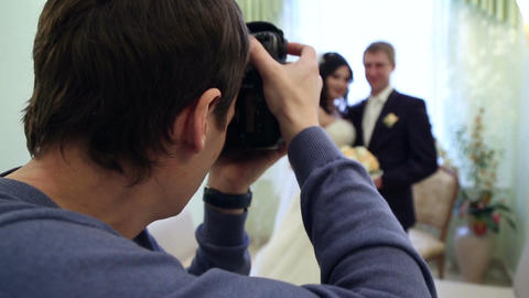 Photographer Shoots Newlyweds stock footage