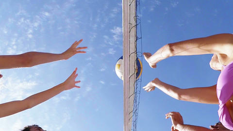 Happy friends playing volleyball Footage