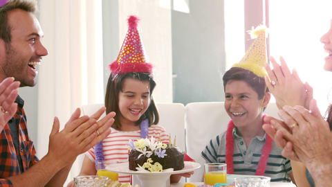 Cute family celebrating cute siblings birthday Footage