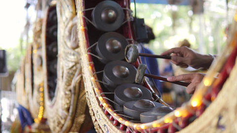 Thai Drummer Playing Music with Drumsticks on Traditional Metal Gong Drum Live Action