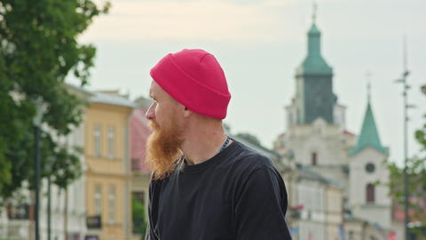 Readhead Hipster in Hat With a Skateboard Photo