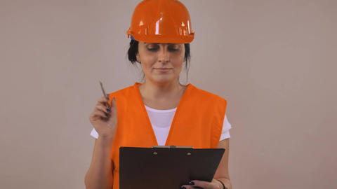 Female worker writing document Image
