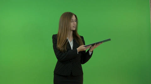 Beautiful business woman making a presentation. On the background of a green Footage