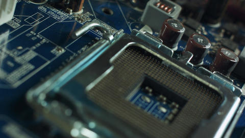 CPU socket and processor on the motherboard. Focus on the motherboard Live Action