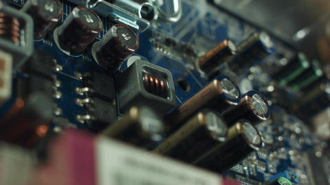 Closeup on electronic board in hardware repair shop, blurred and toned image. Footage