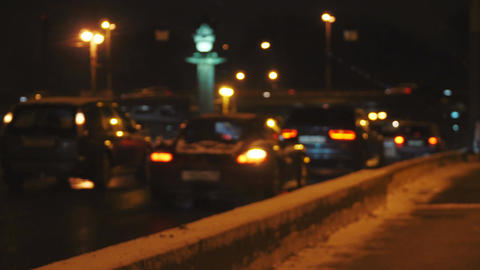 4k defocused night city traffic with cars and tram Footage