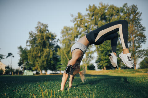 Woman doing yoga exercises in the park Photo
