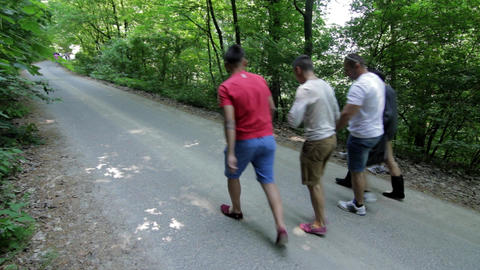 Group of guys go on a road through the forest telling 69 Live Action