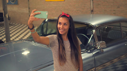 Young Hipser Pin-up Mixed Race Girl Taking Selfie with Mobile Phone at Vintage Filmmaterial
