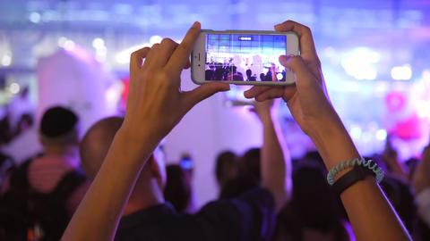 Young Woman Taking Video with Mobile Phones of People Having Fun at New Year Footage