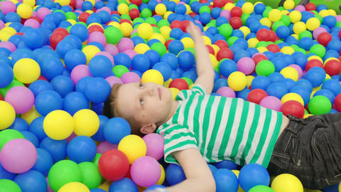 Boy Playing With Colored Balls Footage