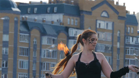 Closeup Girl Performs Fire Show against Residential Complex Footage