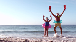 Happy senior couple jumping with hands up Footage