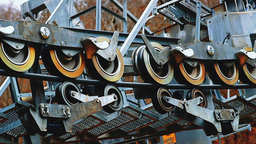 Close-up view of mechanism with rotating rollers driving the cableway Footage