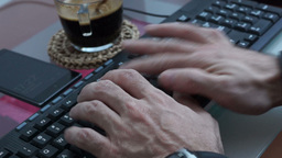 Hands of man with wristwatch and smartband typing on computer keyboard Footage
