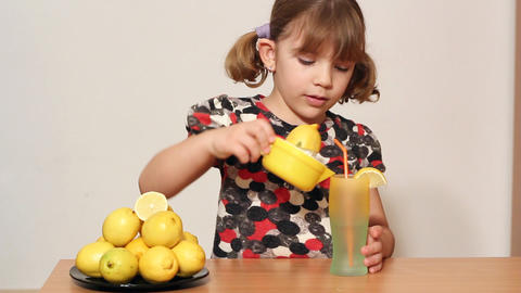 little girl make lemonade Footage