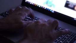 Man hands typing text on the laptop keyboard. Night theme Footage