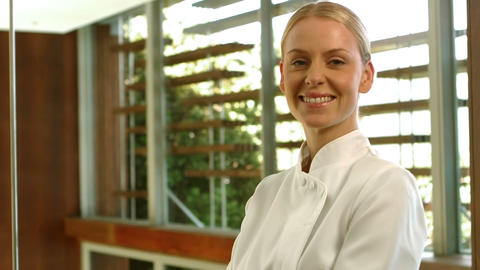 Smiling blond woman posing in uniform Footage
