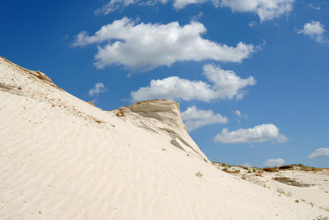 Sandy mountain from white sand Photo