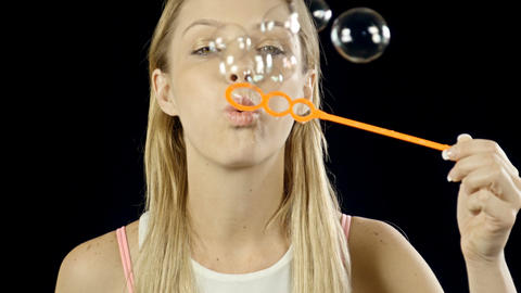 Pretty Woman Blowing Bubbles Footage