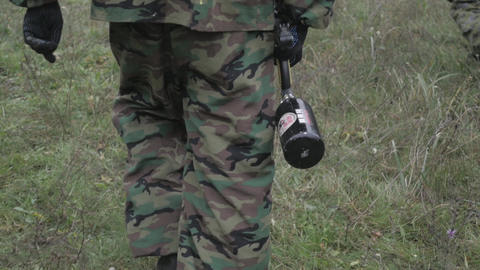 Paintball player walking through the forest in slow motion Footage