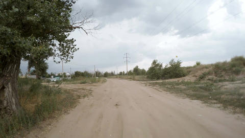 Rear view of car driving along a rural dirt road Footage