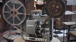 Old film projector with film Footage
