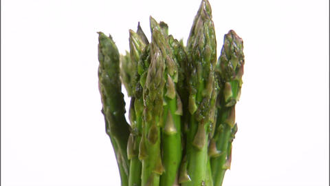 Asparagus rotating on white background ビデオ