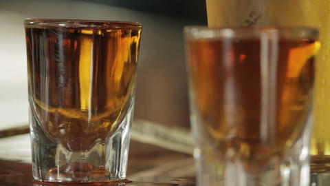 Close up on two shots of whiskey clean shot Live Action