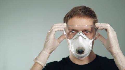 man wears goggles. mask for breathing. protection of the respiratory system and Footage