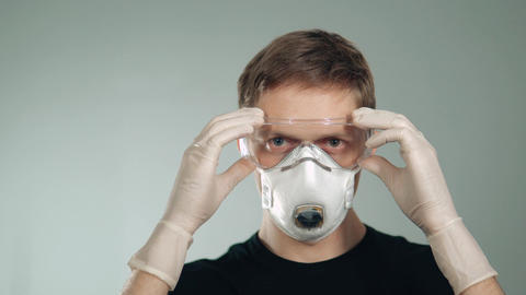 a man wearing a mask wears protective glasses. protection of respiratory organs Footage