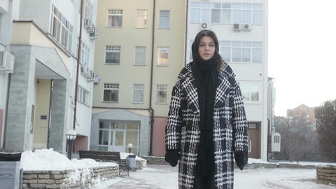 Young woman posing near high-rise building Footage