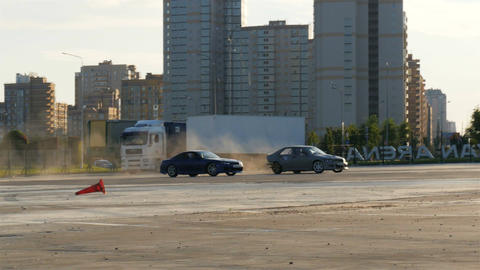 Cars Take Part in Competition on Entertainment Center Territory Footage