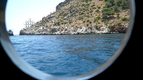 View Of The Coast Of The Mediterranean Sea Through The Porthole Of The Ship 0