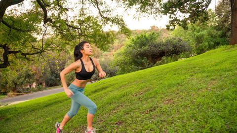 Athletic Woman Running Morning Hill 画像