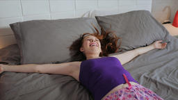 Happy Young Woman Girl Falling On Bed For Happiness Live Action