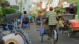 JOGJAKARTA - MAY 2012: transportation with cyclo Footage