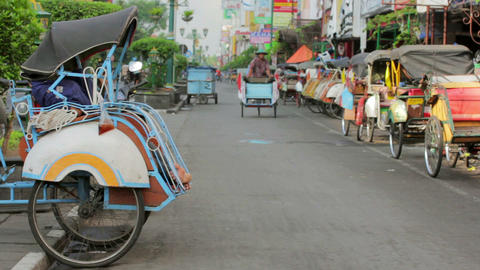 JOGJAKARTA - MAY 2012: transportation with cyclo Stock Video Footage