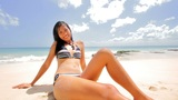 Sunbathing and Tanning at Exotic Beach Footage