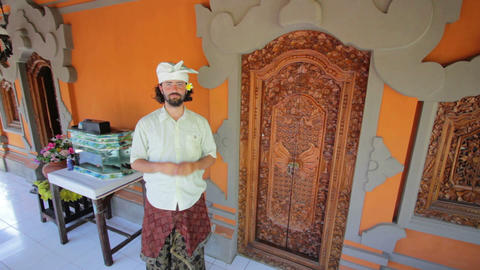 caucasian man in balinese clothes Stock Video Footage